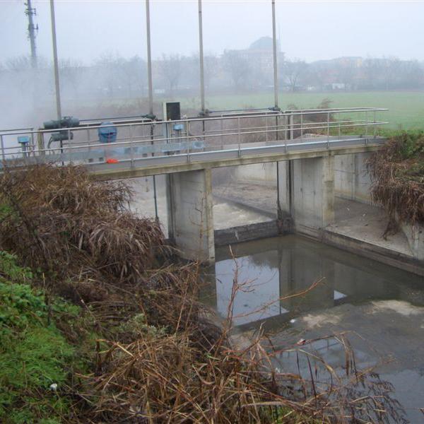 Shallow water underneath bridge